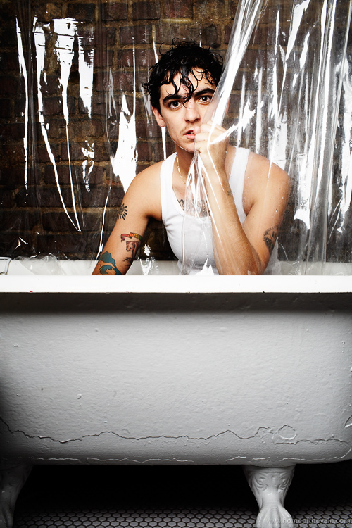 """JD Samson"" at Home of the Vain; Le Tigre's JD Samson in her bathtub in Greenpoint, NYC.Originally published in October 2007 issue of Out magazine."